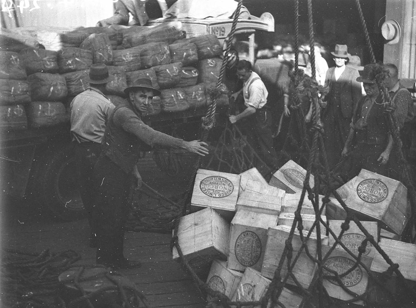 Loading a ship, Sydney Harbour 12 July 1934
