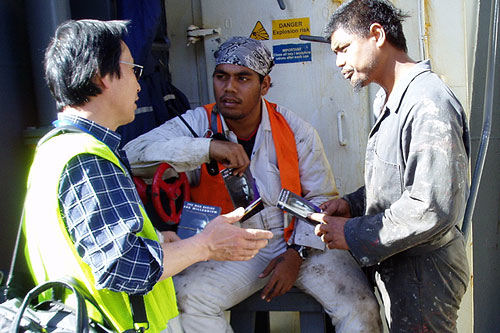Chaplain Jong Nam Jo with two seafarers from MV Hansa Rendburg Image courtesy of Mission to Seamen, Sydney http://www.mts.org.au/sydney.html